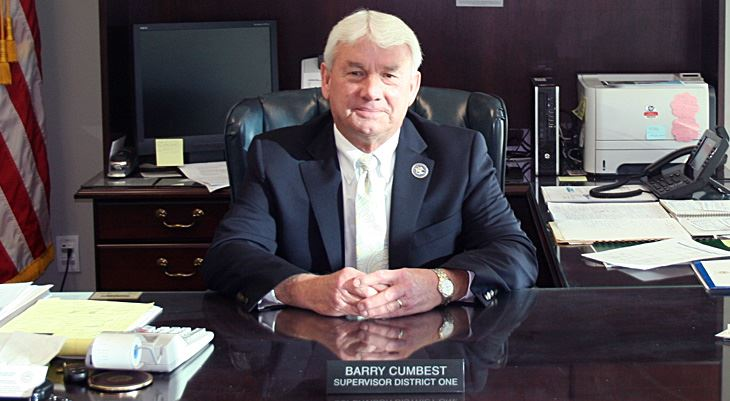 Barry Cumbest sitting behind desk
